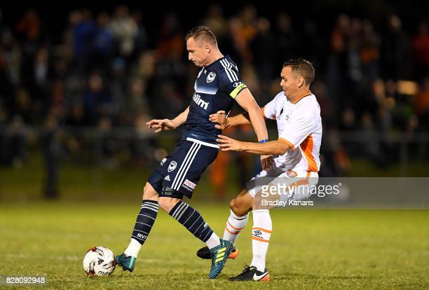 Besart Berisha of the Victory is pressured by the defence of Jade North of the Roar during the FFA Cup round of 32 match between the Brisbane Roar...
