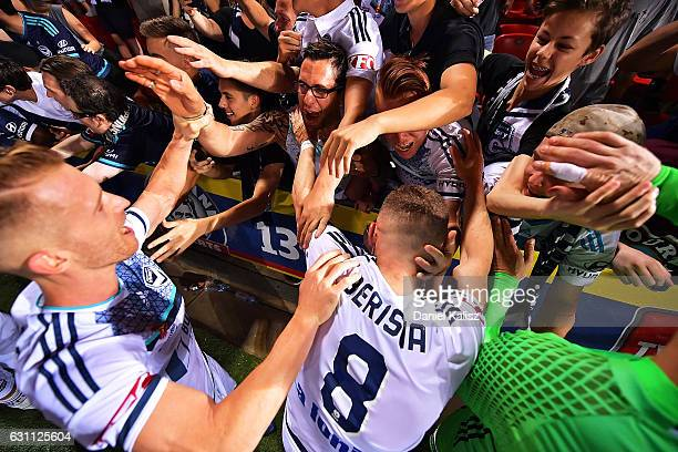Besart Berisha of the Victory rects with fans after the round 14 ALeague match between Adelaide United and Melbourne Victory at Coopers Stadium on...