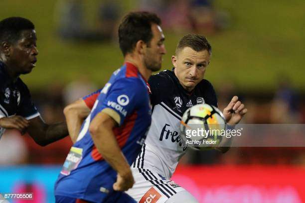 Besart Berisha of the Victory runs after the ball during the round eight ALeague match between the Newcastle Jets and the Melbourne Victory at...