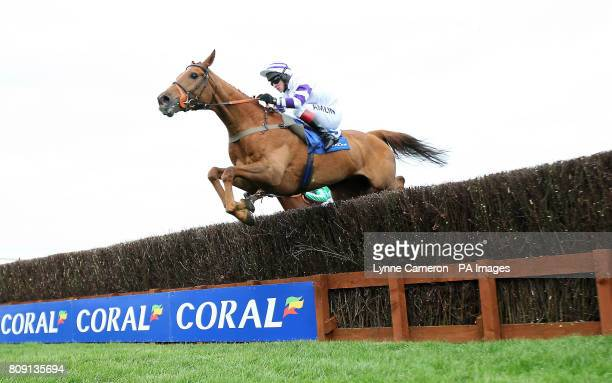 Beshabar riden by Richard Johnson goes on to win The Coral Scottish Grand National Handicap Steeple Chase during day one of the Coral Scottish Grand...
