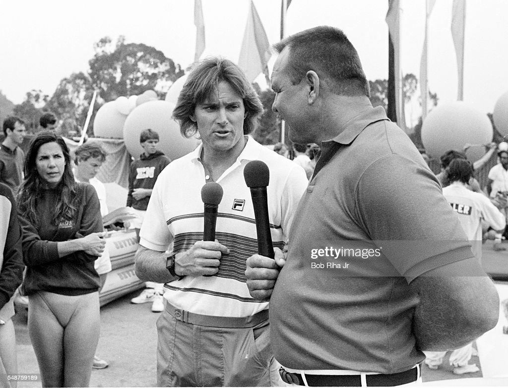 Beside the pool at the University California, Santa Barbara, American former professional athletes Bruce Jenner (left) and <a gi-track='captionPersonalityLinkClicked' href=/galleries/search?phrase=Dick+Butkus&family=editorial&specificpeople=809708 ng-click='$event.stopPropagation()'>Dick Butkus</a> host a swimming event during an episode of the television show 'Star Games', Santa Barbara, California, June 15, 1985. Behind them contestant Patti Davis (daughter of then US President Ronald Reagan) watches.