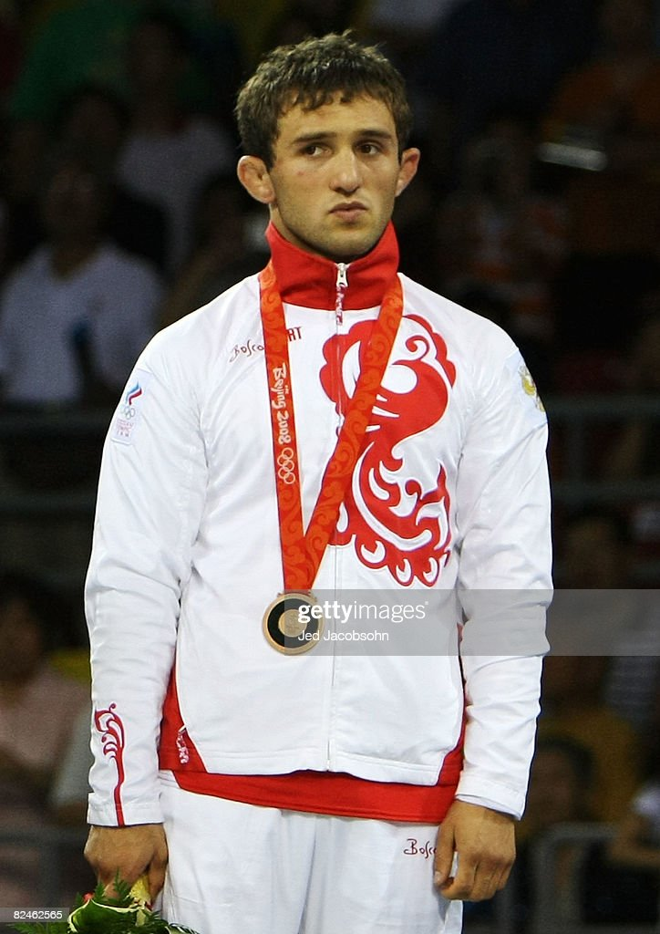 Besik Kudukhov of Russia receives his bronze medal after the men's 55kg freestyle wrestling event at the China Agriculture University Gymnasium on Day 11 of the Beijing 2008 Olympic Games on August 19, 2008 in Beijing, China.