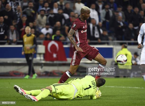 Besiktas' Brazilian midfielder Anderson Talisca vies with Lyon's FrenchPortuguese defender Anthony Lopes during the UEFA Europa League first leg...