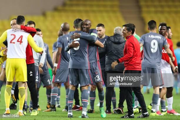 Besiktas' Canadian midfielder Atiba Hutchinson embraces Besiktas' Portuguese defender Pepe after winning the UEFA Champions League group stage...