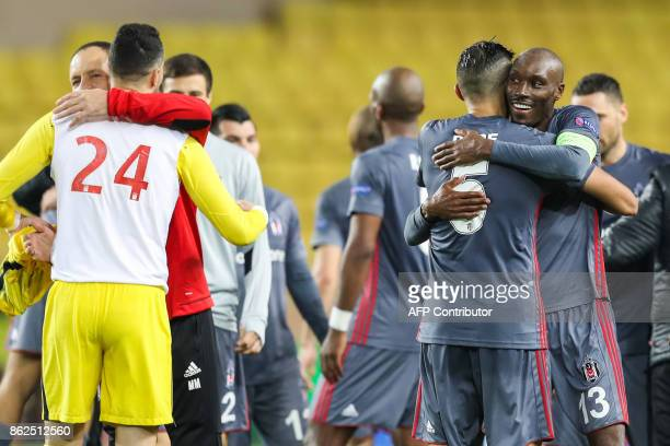 Besiktas' Canadian midfielder Atiba Hutchinson embraces Besiktas' Portuguese defender Pepe after winning the UEFA Champions League group stage...