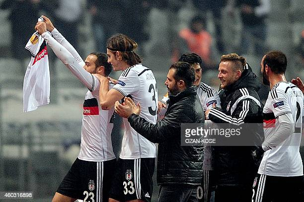 Besiktas' Cenk Tosun celebrates with teammates after scoring a goal during the UEFA Europa League Group C football match Besiktas vs Tottenham at...