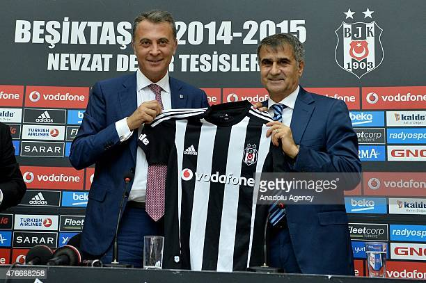 Besiktas club president Fikret Orman and manager Senol Gunes poses with a jersey after Senol Gunes signed a new contract as the new head coach of...