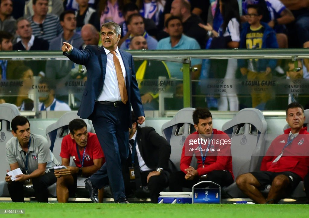 Besiktas' coach Senol Gunes gives instructions to his players from the sideline during the UEFA Champions League football match FC Porto vs Beskitas JK at the Dragao stadium in Porto on September 13, 2017. Besiktas won the match 3-1. /