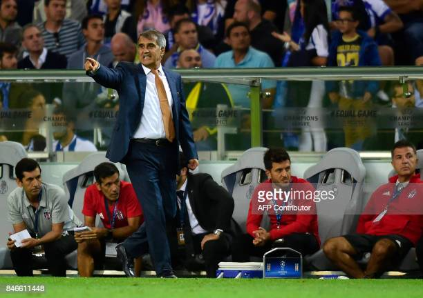 Besiktas' coach Senol Gunes gives instructions to his players from the sideline during the UEFA Champions League football match FC Porto vs Beskitas...