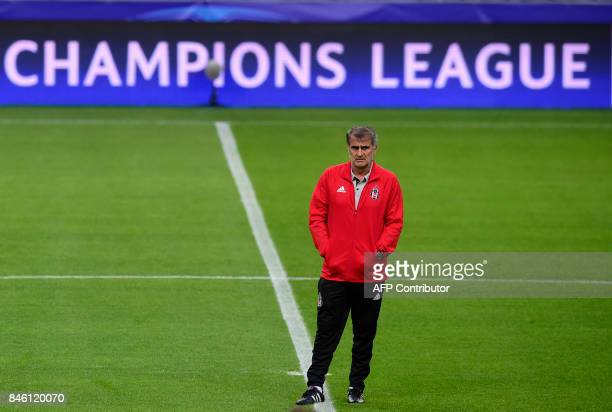 Besiktas' coach Senol Gunes stands on the field during a training session on the eve of the UEFA Champions League Group G football match FC Porto vs...