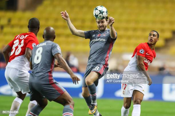 Besiktas' defender Caner Erkin heads the ball as Monaco's Belgian midfielder Youri Tielemans looks on during the UEFA Champions League group stage...