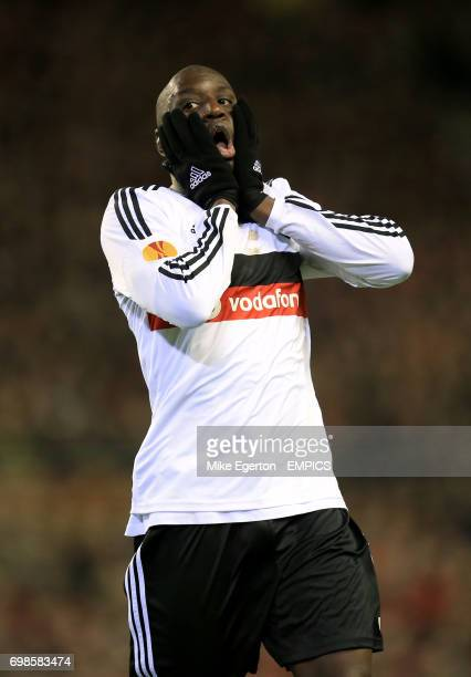 Besiktas' Demba Ba rues a missed chance on goal which was saved by Liverpool goalkeeper Simon Mignolet