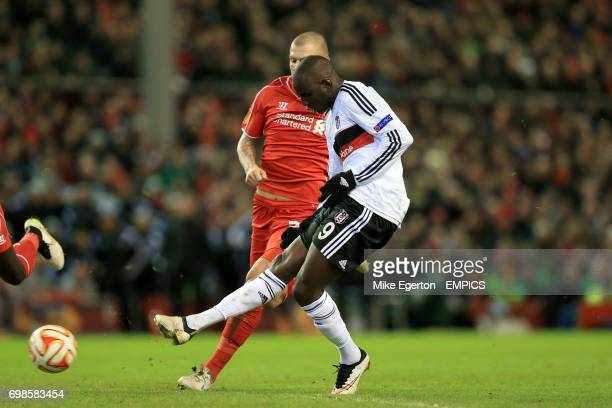 Besiktas' Demba Ba with a chance on goal which was saved by Liverpool goalkeeper Simon Mignolet