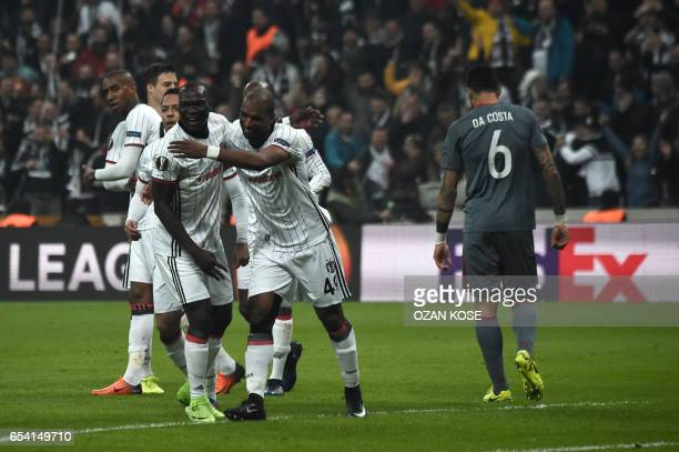 Besiktas' Dutch midfielder Ryan Babel celebrates with his teammate Vincent Aboubakar after scoring a goal against Olympicos during their UEFA Europa...
