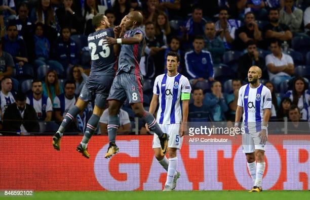 Besiktas' Dutch midfielder Ryan Babel celebrates with teammate forward Cenk Tosun after scoring during the UEFA Champions League football match FC...