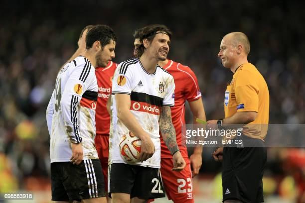 Besiktas' Ersan Gulum argues with referee Szymon Marciniak after the award of a penalty