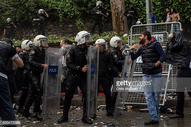 Besiktas fan yells at police after tear gas was used to disperse fans trying to enter the stadium ahead of the opening match of the new Vodafone...