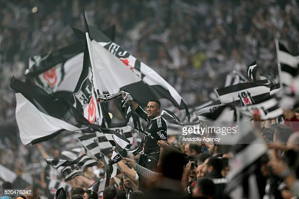 Besiktas fans are seen during the Turkish Super Toto Super Lig football match between Besiktas and Bursaspor at Vodafone Arena in Istanbul Turkey on...