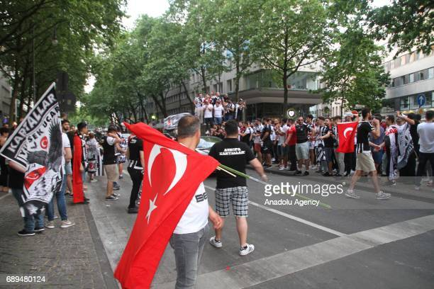 Besiktas fans celebrate after they won their 15th Turkish Spor Toto Super Lig title by defeating Gaziantepspor 40 in Cologne Germany on May 28 2017