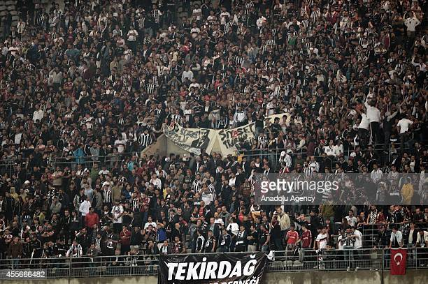 Besiktas' fans cheer their team during the UEFA Europa League Group C soccer match between Besiktas and Asteras at Ataturk Olimpiyat Stadium in...