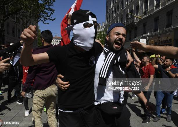 Besiktas' fans gather in the streets of Lyon hours before the Europa League football match Lyon vs Besiktas on April 13 2017 / AFP PHOTO / PHILIPPE...