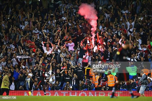 Besiktas fans light a flare as Demba Ba of Besiktas celebrates scoring the equalising goal during the UEFA Europa League Group C match between...