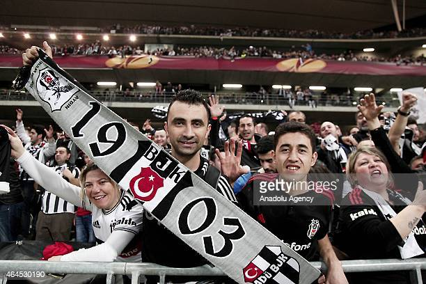 Besiktas fans show their support during the UEFA Europa League Round of 32 match between Besiktas and Liverpool at Ataturk Olympiad Stadium in...