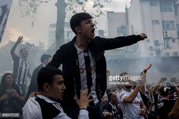 Besiktas fans sing and cheer on the street ahead of the opening match of the new Vodafone Arena between Besiktas and Bursaspor on April 11 2016 in...