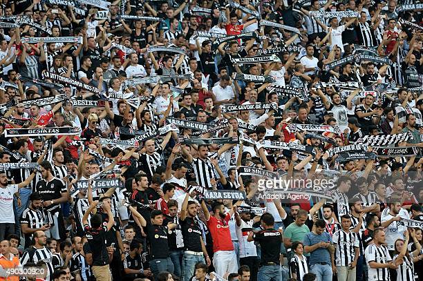 Besiktas fans support their team as they watches the Turkish Spor Toto Super League derby match between Besiktas and Fenerbahce at Ataturk Olympic...
