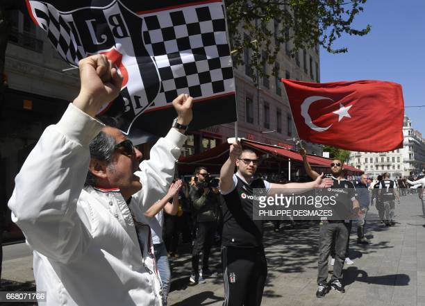 Besiktas' fans wave their club's and Turkey's national flags in the streets of Lyon hours before the Europa League football match Lyon vs Besiktas on...