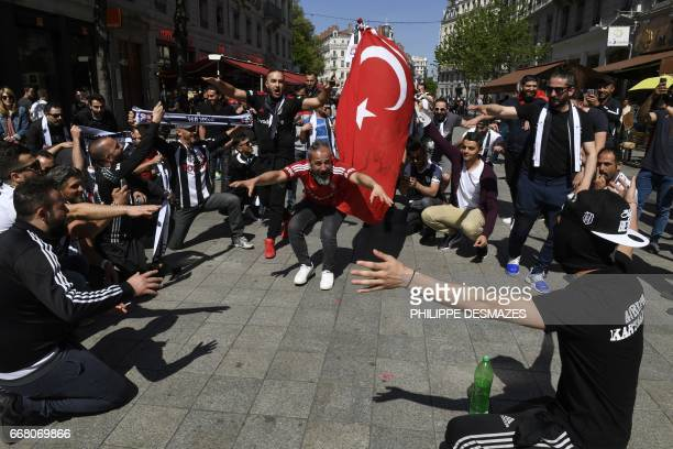 Besiktas' fans wave Turkey's national flag as they gather in the streets of Lyon hours before the Europa League football match Lyon vs Besiktas on...