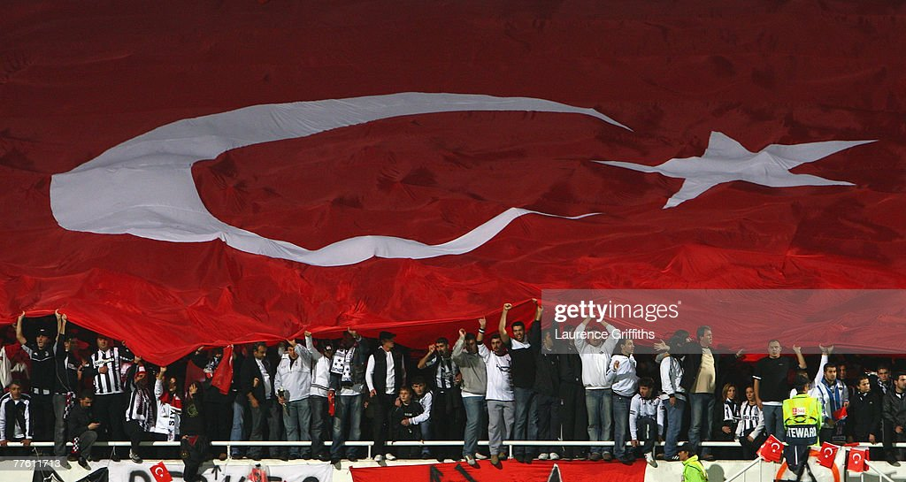Besiktas fans with the Turkish Flag during the UEFA Champions League Group A match between Besiktas and Liverpool at the Inonu Stadium on October 24...