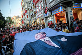 Besiktas football club supporters hold a giant poster of founder of the Republic of Turkey Mustafa Kemal Ataturk during a protest against the...