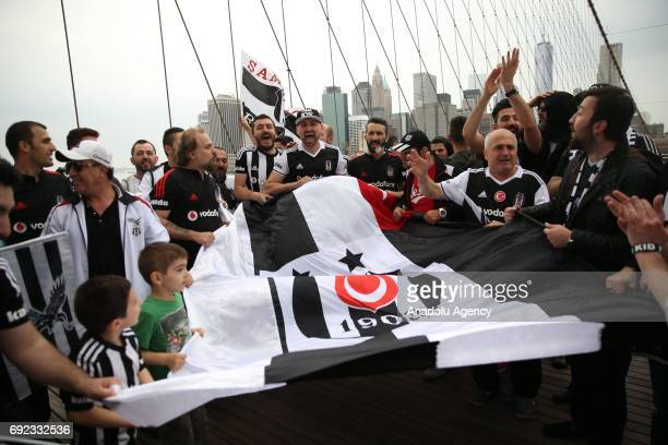 Besiktas Football Club supporters in New York celebrate Turkish Spor Toto Super Lig 20162017 season championship trophy at Brooklyn Bridge of New...