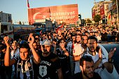 Besiktas football club supporters shout slogans during a protest against the military coup on Taksim square in Istanbul on July 23 2016 Turkey pushed...