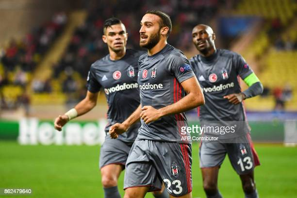 Besiktas' forward Cenk Tosun celebrates after scoring an equalizer during the UEFA Champions League group stage football match between Monaco and...