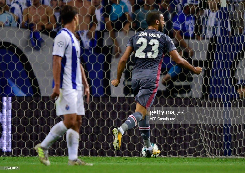 Besiktas' forward Cenk Tosun celebrates after scoring during the UEFA Champions League football match FC Porto vs Beskitas JK at the Dragao stadium in Porto on September 13, 2017. /