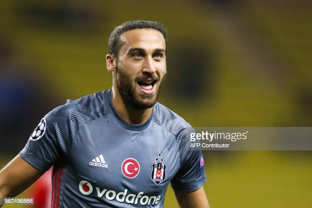 Besiktas' forward Cenk Tosun celebrates after scoring his second goal during the UEFA Champions League group stage football match between Monaco and...