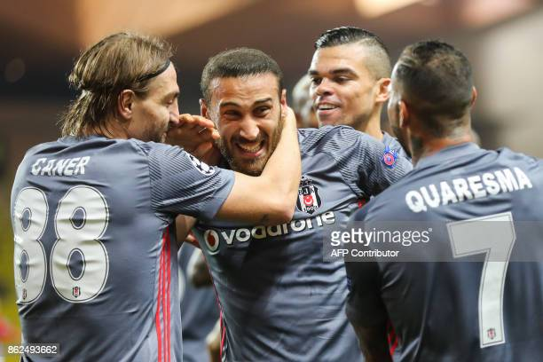 Besiktas' forward Cenk Tosun celebrates with Besiktas' defender Caner Erkin Besiktas' Portuguese defender Pepe and Besiktas' Portuguese midfielder...