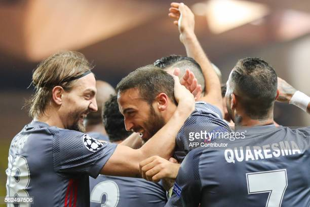 Besiktas' forward Cenk Tosun celebrates with Besiktas' defender Caner Erkin and Besiktas' Portuguese midfielder Ricardo Quaresma after scoring his...