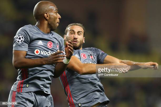 Besiktas' forward Cenk Tosun celebrates with Besiktas' Dutch midfielder Ryan Babel after scoring his second goal during the UEFA Champions League...