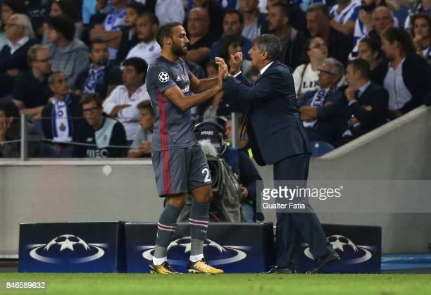 Besiktas forward Cenk Tosun celebrates with Besiktas head coach Senol Gunes after scoring a goal during the UEFA Champions League match between FC...