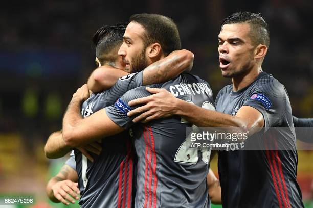 Besiktas' forward Cenk Tosun celebrates with Besiktas' Portuguese defender Pepe and teammates after scoring an equalizer during the UEFA Champions...