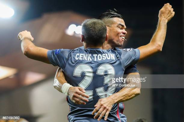 Besiktas' forward Cenk Tosun celebrates with Besiktas' Portuguese defender Pepe after scoring his second goal during the UEFA Champions League group...