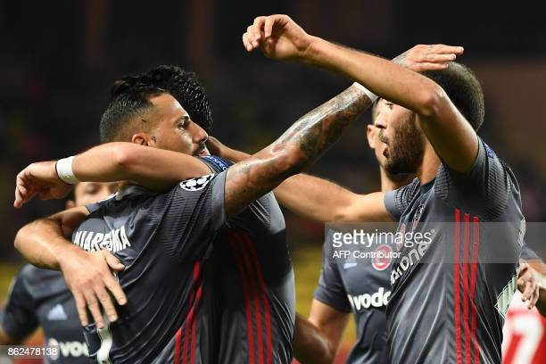Besiktas' forward Cenk Tosun celebrates with Besiktas' Portuguese midfielder Ricardo Quaresma after scoring an equalizer during the UEFA Champions...