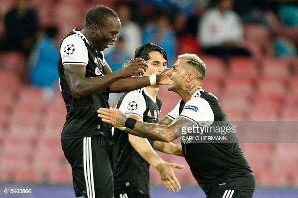 Besiktas' forward from Cameroon Vincent Aboubakar celebrates with Besiktas' forward from Portugal Ricardo Quaresma after scoring during the UEFA...
