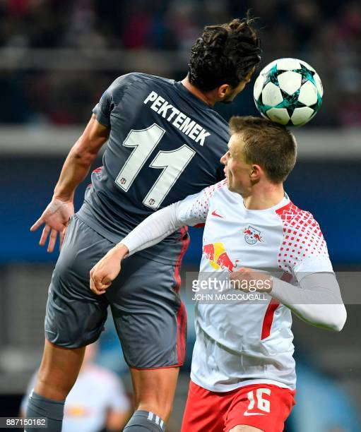 Besiktas' forward Mustafa Pektemek and Leipzig's German defender Lukas Klostermann vie for the ball during the UEFA Champions League group G football...