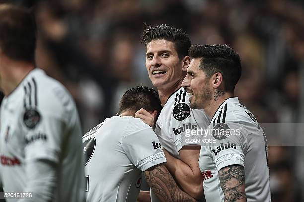 Besiktas' German forward Mario Gomez celebrates with teammates after scoring a goal against Bursaspor during the Turkish Spor Toto Super league...