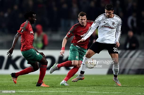 Besiktas' German forward Mario Gomez vies for the ball with Lokomotiv's Slovakian defender Jan Durica and Senegalese forward Baye Oumar Niasse during...