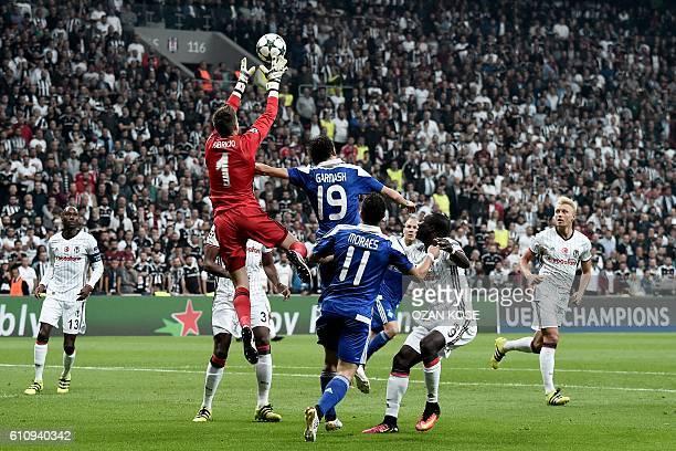 Besiktas' goalkeeper Fabri saves a shot on goal by Dynamo Kiev's Denys Garmash during the UEFA Champions League football match between Besiktas and...